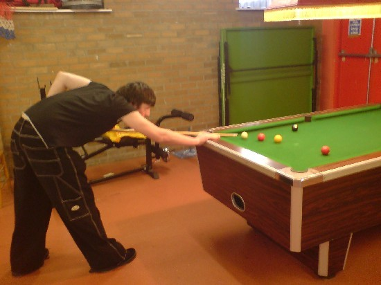 Youngster playing pool